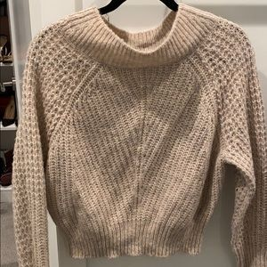 Beautiful pale pink/beige knitted sweater.